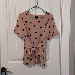 Polka dot blouse. Pink and black